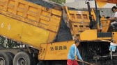 paver : 19 August 2018. Suzhou, China. Pavement machine laying fresh asphalt during highway construction