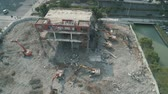 deconstruct : 16 October, 2018. Suzhou city, China. Aerial drone view of abandoned building demolition between modern office skyscrapers.. Demolition excavators.