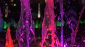 fountain show : Close-up slow motion view of beautiful colorful fountain on city street at night. Stock Footage