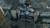 helicóptero : Suzhou, China - October 27, 2018: Aerial over modern business office buildings, skyscrapers, financial district, cityscape with downtown buildings on the sunset Vídeos