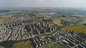 stadt straße : Aerial over suburb, village, fields and rivers on sunny day Stock Footage