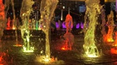 renk : Close-up view of beautiful colorful fountain on city street at night.