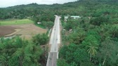 impresionante : Aerial drone shot of concrete road in a small farming community. Aerial view of countryside road. Philippines, El Nido.