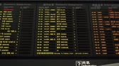 várakozás : Shanghai, China - November 26, 2018: Schedule board displaying flight information in the departure hall of Shanghai Pudong International Airport. Stock mozgókép