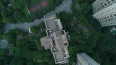 blok mieszkalny : Aerial vertical shot over residential apartment buildings on sunset. Aerial shot over community apartment complex in China.