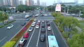 construcción de carreteras : Suzhou, China - June 30, 2019: Aerial view of cars running on the city road at sunset, China. Archivo de Video
