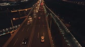 otoyol : Aerial top view of highway interchange at night. Aerial top view of road junction from above, automobile traffic and jam of many cars, useful for engineering, industrial, transportation concept Stok Video