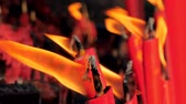 wiara : Close-up slow motion shot of a candles burning in a Buddhist temple., China. Wideo