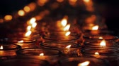 ofrenda : Close-up shot of a candles burning in a Buddhist temple., China.