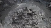 geológia : Bubbling hot mud pool in slow motion Stock mozgókép