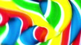 movimento circular : Close view of a bright vibrant lollypop spinning quickly in circles. Stock Footage