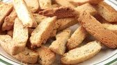 italiano : Almond nut biscotti being taken from plate Vídeos