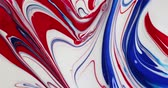 arte abstrata : Using a paintbrush with wide strokes to make an abstract painting with red white and blue poster paint.