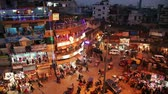 hlavní : New Delhi, INDIA -  January 21: Night view of Main bazar Pahar Ganj street in New Delhi. People, cars, motorbikes and auto rickshaws on the street near by shops in New Delhi on January 21, 2013. Main Bazar is a big market located just west of the New Delh