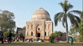 lodi : New Delhi, India - January 20: Bara Gumbad  tomb in Lodi Garden, New Delhi on January 20, 2013. Indian families come to Lodi Gardens at weekend to have picnics and play with their children.