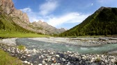зелень : Mountain river at blue sky in Dzungarian Alatau,  Kazakhstan, Central Asia
