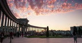 зелень : ALMATY, KAZAKHSTAN JULY 3, 2015 People walking near entrance of dendra park of first president Nursultan Nazarbayev with arches and columns in time lapse
