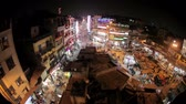 pobreza : New Delhi, INDIA -  MARCH 21, 2015: Night view of Main bazar Pahar Ganj street in New Delhi. People, cars, motorbikes and auto rickshaws on the street near by shops at night
