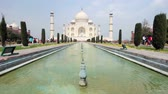 built structure : Taj Mahal and fountain view at bright clear day in Agra, India
