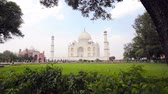 built structure : Taj Mahal view with green lawn at clear bright day in Agra, India