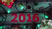 cartão de natal : New Year calendar 2016 at wooden background whith festival lights