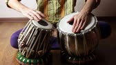Man playing on traditional Indian tabla drums close up Stock Footage