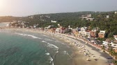 Kovalam ligthhouse tropical crowdy beach with resort in Kerala, India. View from the top.