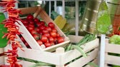 jardinier : Cherry tomatoes and greengrocer stand in the case.