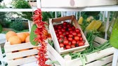 корзина : Cherry tomatoes and greengrocer stand in the case.