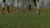 погоня : Running soccer players playing football match on sports field. Low angle view. Football team attacking opponents goal , teammates passing and stricker shooting on goal.