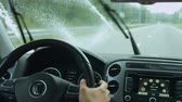 přístrojová deska : View of windshield wipers cleaning windscreen whilst car riding on freeway. Male driver riding in car on empty asphalt road. Interior of moving vehicle on road with wipers cleaning dirty windshield.