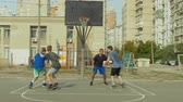 drible : Offensive streetball team scoring field goal in the paint while playing basketball game on outdoor court. Baskteball player making successful assit to his teammate during streetball match ooutdoors.