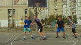 drible : Handsome teenage basketball player completing offense with jump shot and scoring points while playing streetball game on outdoor court. Young streetball player taking jump shot to score points outdoor