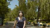 inline : Portrait of active female in helmet rollerblading along footpath of summer park on sunny day. Positive carefree woman roller riding at speed enjoying summer leisure, healthy activity concept. Stock Footage