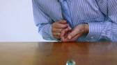 perfeição : Man in a tie and dress shirt launches a marble across his desk. Stock Footage