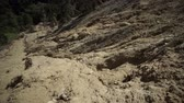 landslide : Tilt up shot of a large clay based soil landslide or mudslide in the Andes mountains of Ecuador.