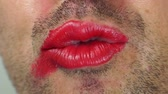 cinsel : Close up shot of a man with whiskers moving his lipstick makeup covered lips and struggling with his sexuality.