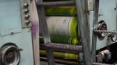 газета : Shot of the yellow printing drum on an industrial offset newspaper printing press.