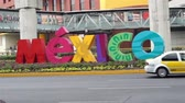 návštěvníci : MEXICO CITY, MEXICO - APRIL 11, 2016: Handheld shot of the colorful Mexico sign welcoming visitors outside of the Benito Juarez Mexico City International Airport.