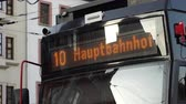 HALLE, GERMANY - APRIL 21, 2017: Handheld shot of a sign on a public transport rail train tram going to the Hauptbahnhof or main train station in Halle Germany. Стоковые видеозаписи