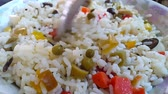 scrambling : Chef shakes rice salad