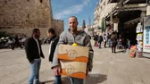 JERUSALEM, ISRAEL - FEBRUARY 10, 2015: Seller of fruits and vegetables carries boxes in his shop in the bazaar of the old city of Jerusalem