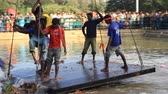 drench : Men cleaning the water body after immersing Gods idols - Dussehra Stock Footage