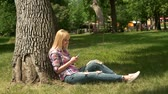 copy : Girl on nature with telephone