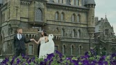 copy : Happy beautiful bride and groom walking near the castle