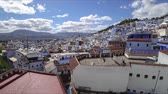 maroc : Chefchaouen, Morocco - May 2018: 4K Timelapse of famous Medina blue old city Chefchaouen, Morocco Stock Footage