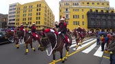 commander : Lima, Peru - September 2017: Soldiers on horse playing music in the military parade at Plaza Mayor, Plaza de Armas of Lima
