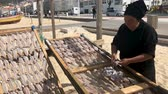 fishmarket : Nazare, Portugal - April 2018: Traditional fish-drying on the beach of Nazare, Portugal. Nazare is a fishermen village on the Atlantic coast of Portugal