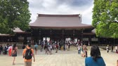 tile : Tokyo, Japan - August 2018: Meiji Shrine located in Shibuya is the Shinto shrine that is dedicated to the deified spirits of Emperor Meiji and his wife, Empress Shoken.