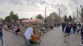 vendor : Istanbul, Turkey - December 2018: Man sells traditional baked pasteries called Simit in Sultanahmet district infront of Blue Mosque Stock Footage